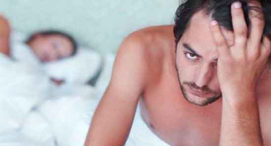 man with erectile dysfunction in bed